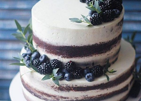 simple wedding cake with cherries and greenery