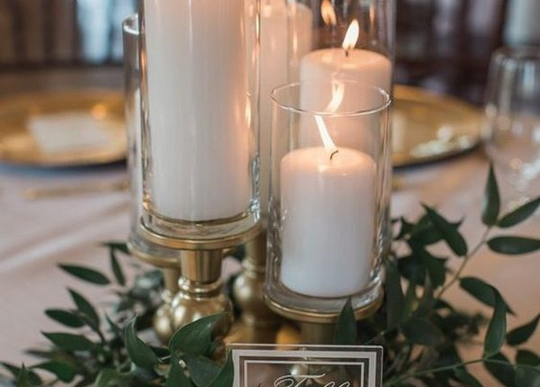 simple wedding centerpiece ideas with candles and greenery