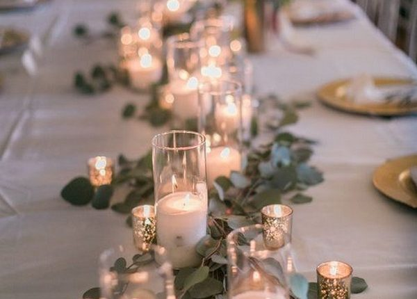 vintage candle and greenery wedding centerpiece