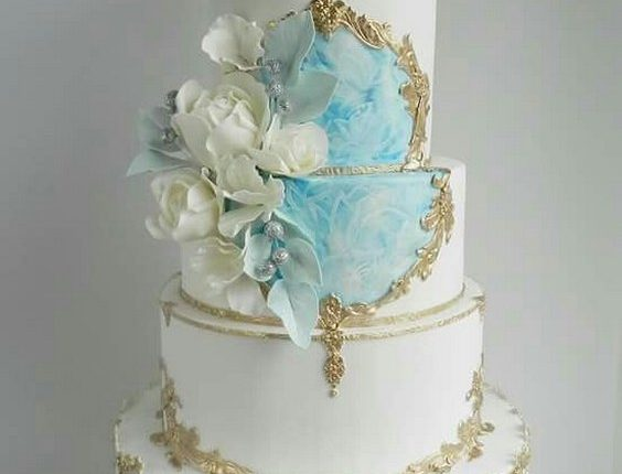 Blue and gold on a white cake