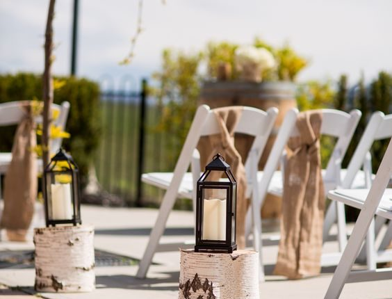 Burlap chair bows, rustic stand with lanterns