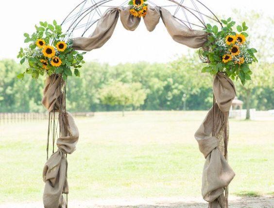 Farm sunflowers and burlap wedding arch