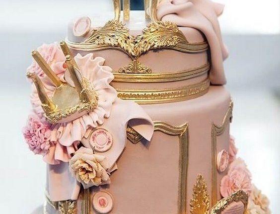 Fondant Louis XIV chairs tumbled down this ornately gilded wedding cake