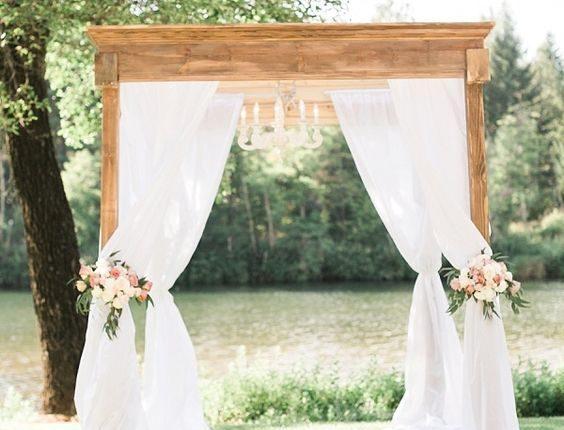 Gorgeous draped fabric ceremony arbor