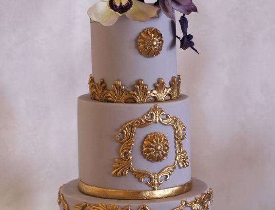 Purple and gold cake. Sugar humming bird and orchids