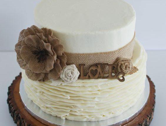 Rustic wedding cake with burlap and buttercream ruffles