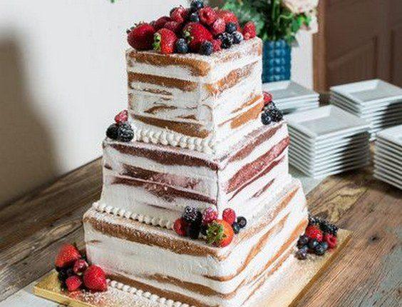 Semi-naked wedding cake idea – square, four-tier wedding cake with fresh berries