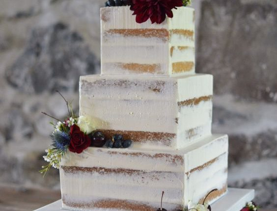 Square semi naked cake on a floral cake stand