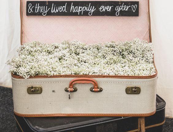 Suitcase filled with gypsophilia wedding decor