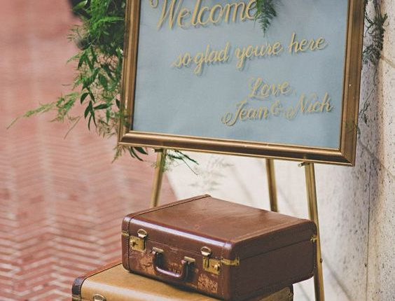 Vintage-inspired suitcase welcome sign decor