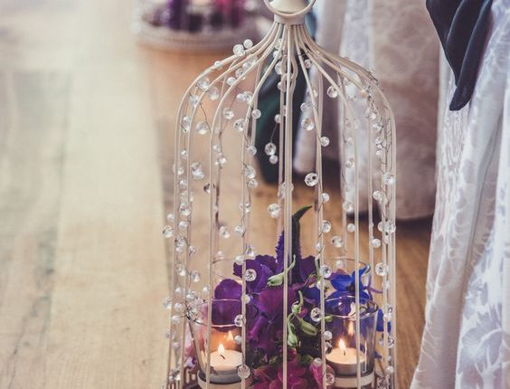 Vintage shabby chic birdcages to line the aisle