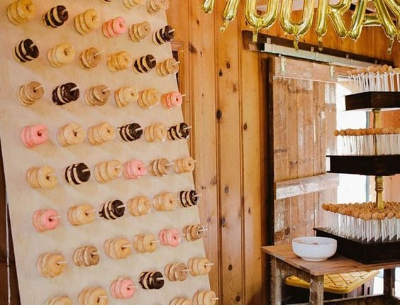 Wedding reception donut wall and cake pop station