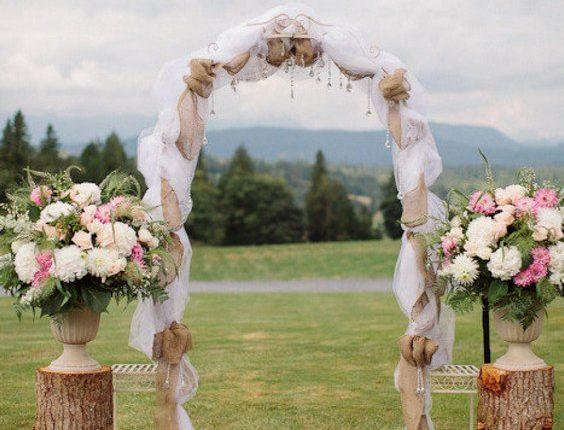 burlap and tree stump wedding arch
