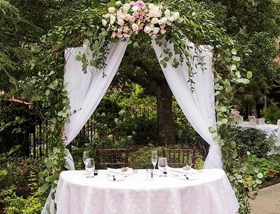 elegant sweetheart table with greenery