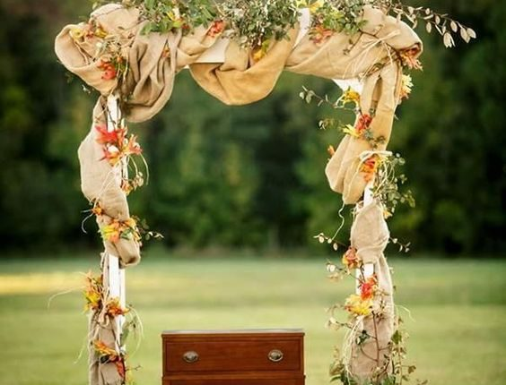 fall wedding arch with leaves and burlap