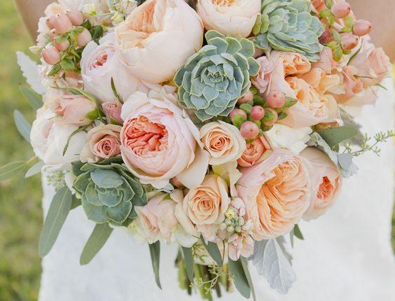 green foliage. and peach garden roses wedding bouquet