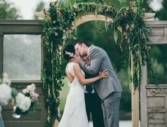 greenery and old door wedding backdrop