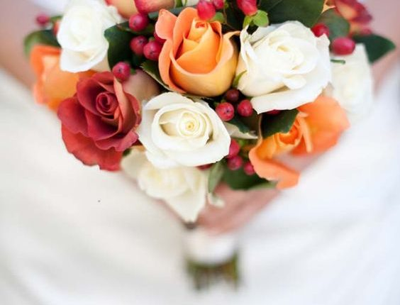 ivpry and orange fall wedding bouquet