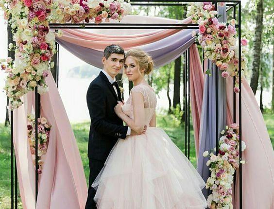 pastel fabric wedding arch