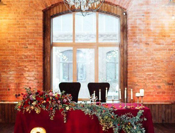 rustic burgundy and greenery wedding sweetheart table decor