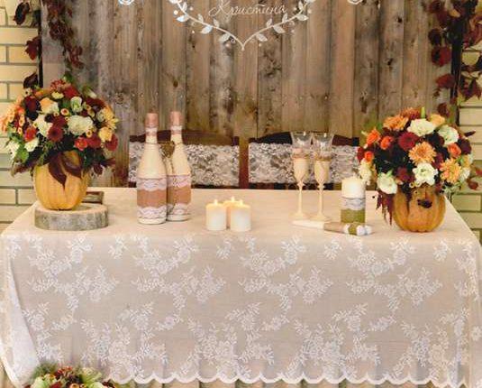 rustic burgundy and orange fall wedding recetion sweetheart table decor