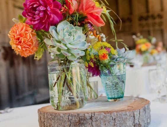 rustic tree stump and succulent wedding centerpiece