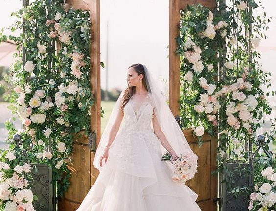 rustic wedding decor backdrop old door with greenery and blush flowers