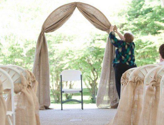 simple burlap wedding arch and aisle