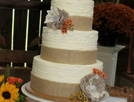 textured buttercream wedding cake with monogram wooden topper and burlap