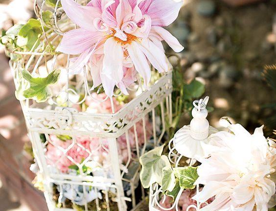 vintage blush pink flowers and white birdcage wedding decor