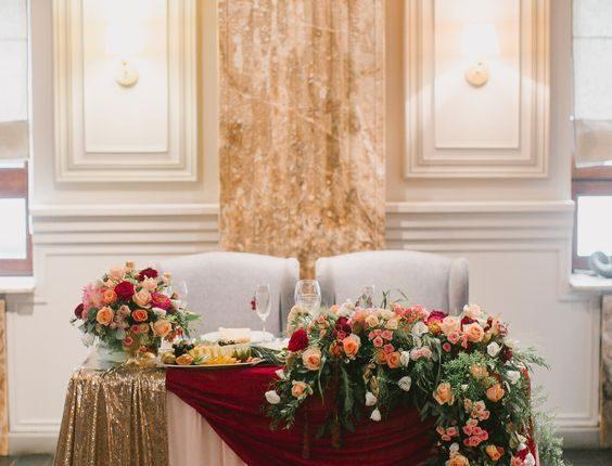 vintage fall gold burgundy and greenery wedding head table decor