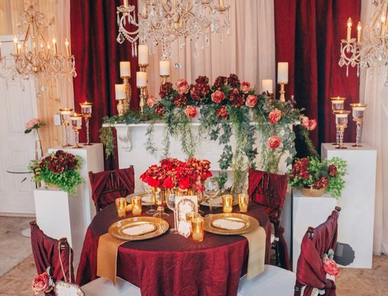 vintage fall gold deep red and greenery sweetheart table for wedding reception