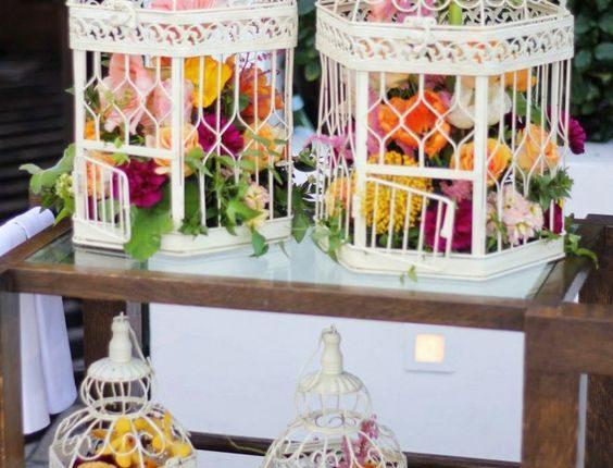 vintage white birdcage and orange wedding flowers wedding decor ideas