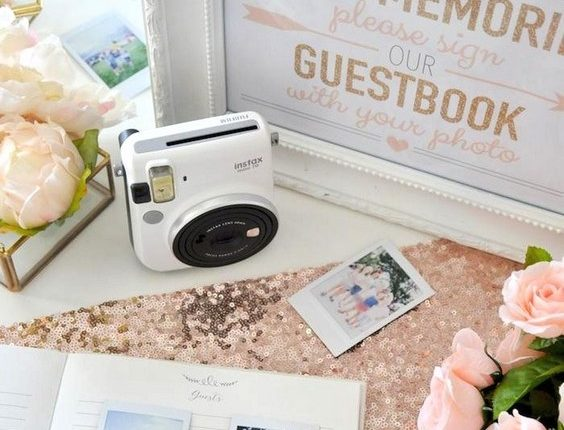 vintage white wedding guest book with polaroid