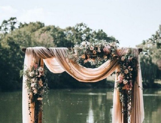 wedding arch with fabric draping + floral