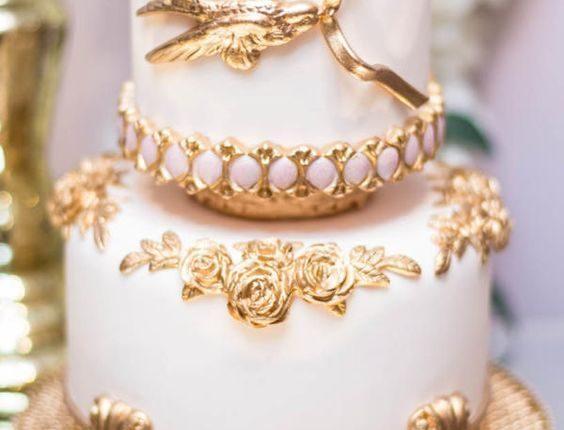 white and gold bird baroque wedding cake