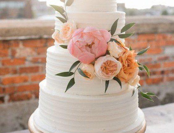 white buttercream wedding cake with peach garden roses