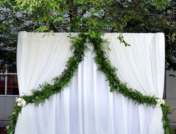 white curtain arch with simple draped garland