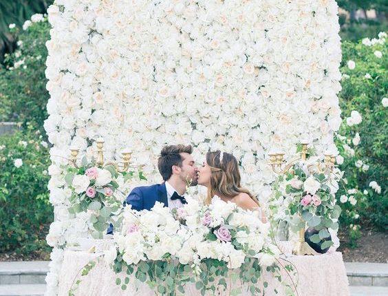 Lush greenery floral wall wedding backdrop