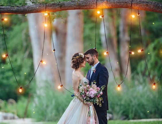 Whimsical tree wedding backdrop with bistro lights