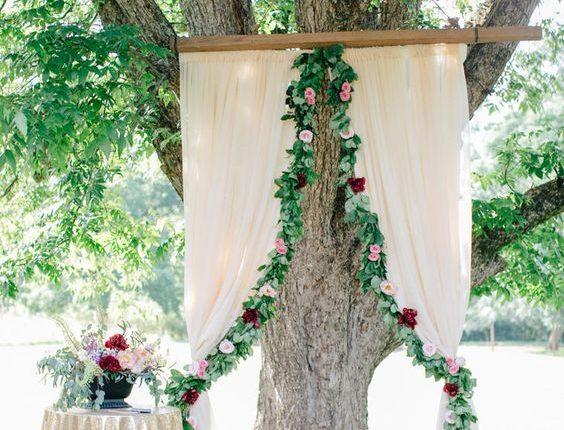 burgundy and greenery and Oak Tree wedding backdrop
