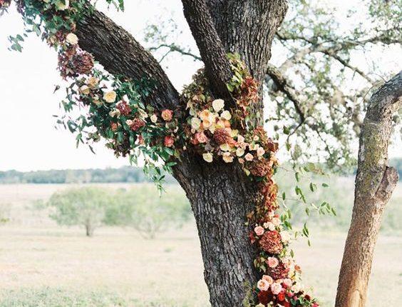 fall burgundy red flowers wedding tree backdrop