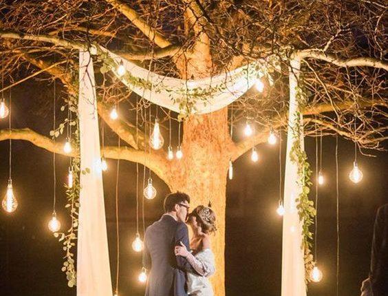 lit tree as wedding ceremony backdrop