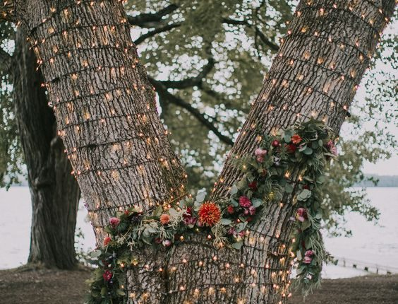 lit tree wedding ceremony backdrop