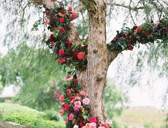 wedding ceremony tree adorned with hundreds of blooms