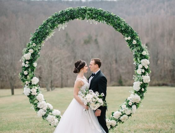 circle floral arbor from colorful wedding inspiration shoot