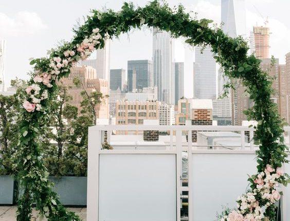 modern giant floral wreath wedding ceremony backdrop