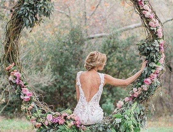 pink and greenery wedding wreath backdrop