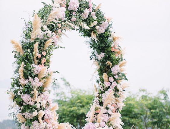 stunning circular floral arch for a beautiful wedding