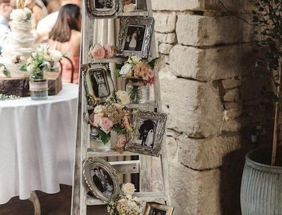 vintage ladder filled with family photographs